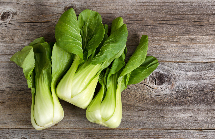 Overhead shot of Chinese cabbage, Bok Choy, on rustic wood